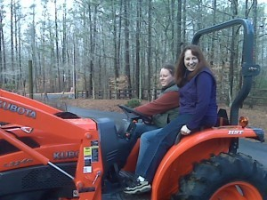 Ashley and Brandy on the new tractor